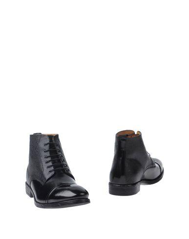 Полусапоги и высокие ботинки от GINO ROSSI