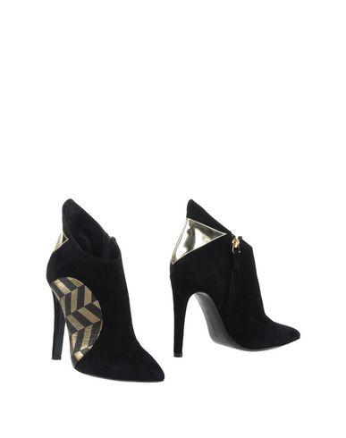 Полусапоги и высокие ботинки от CHARLINE DE LUCA