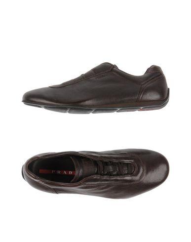 Низкие кеды и кроссовки PRADA SPORT 11192241MF