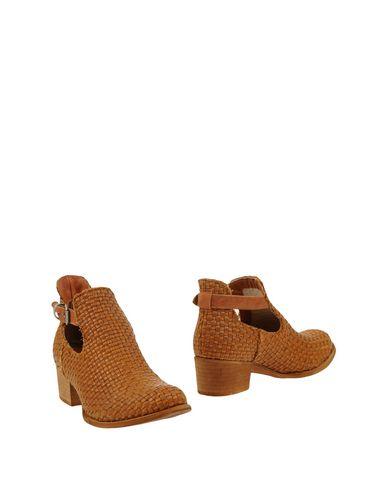 Полусапоги и высокие ботинки FABRIZIO CHINI. Цвет: желто-коричневый