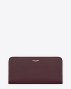 Large Classic Saint Laurent PARIS Zip Around Wallet In dark magenta Leather