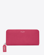 CLASSIC RIVE GAUCHE ZIP AROUND WALLET WITH MONOGRAMMED PULL in LIPSTICK FUSCHIA GRAINED LEATHER