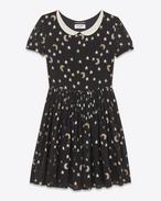 Schulmädchenkleid aus schwarzem, silberfarbenem und goldenem Seidengeorgette mit Mondstickerei