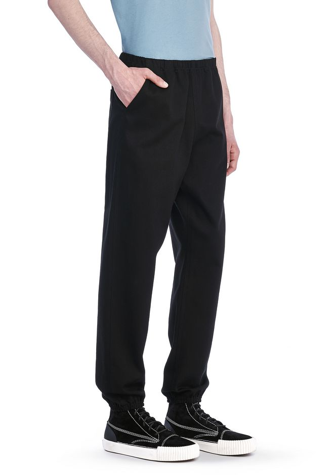 ALEXANDER WANG PANTS Men ELASTICATED CHINOS WITH GIRLS EMBROIDERY