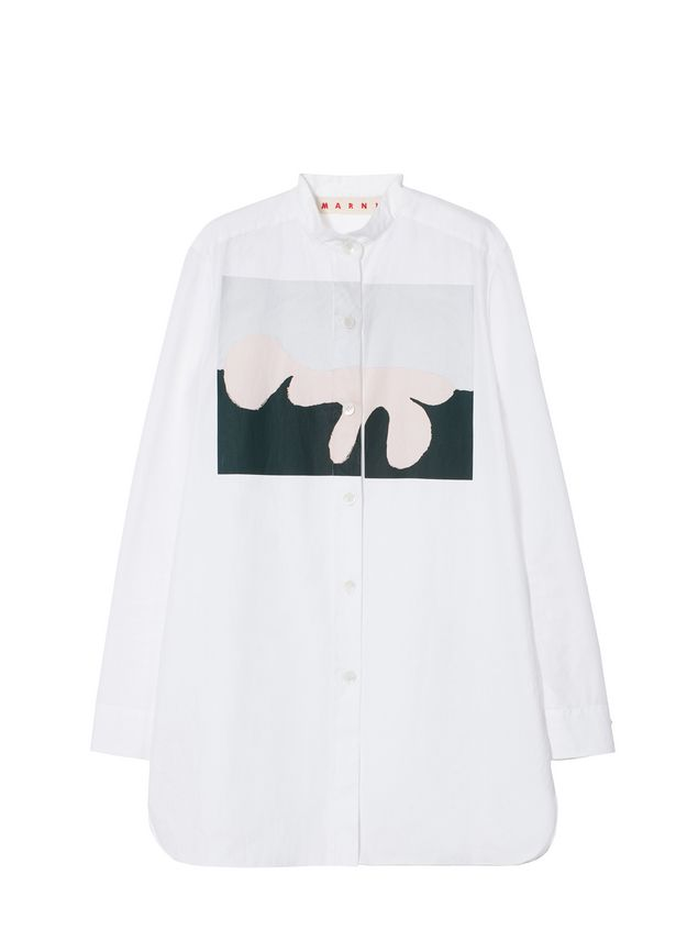 韩式领长袖衬衫,袖口设计有双扣. 可见的搭门,侧边圆形开衩.