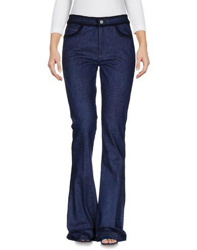 Джинсовые брюки MIU MIU 42522544GO