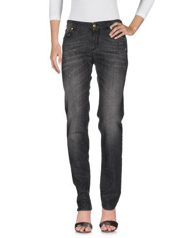 Джинсовые брюки VERSUS 42546472HQ