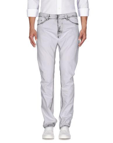 Джинсовые брюки BALENCIAGA 42552542GF