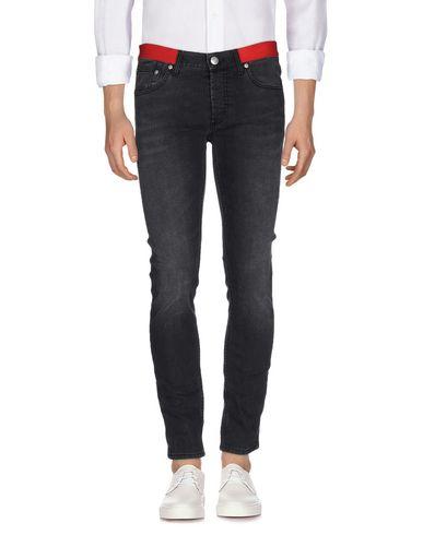 Джинсовые брюки ALEXANDER MCQUEEN 42560510HB