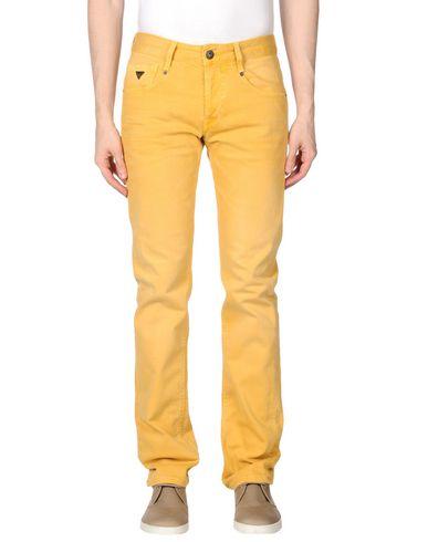 Джинсовые брюки GUESS. Цвет: охра