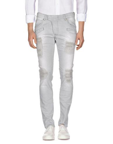 Джинсовые брюки PIERRE BALMAIN 42567267WI