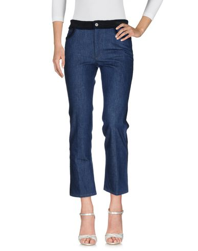 Джинсовые брюки MIU MIU 42568970UV