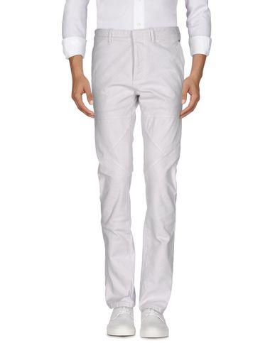 Джинсовые брюки BALENCIAGA 42569308HO