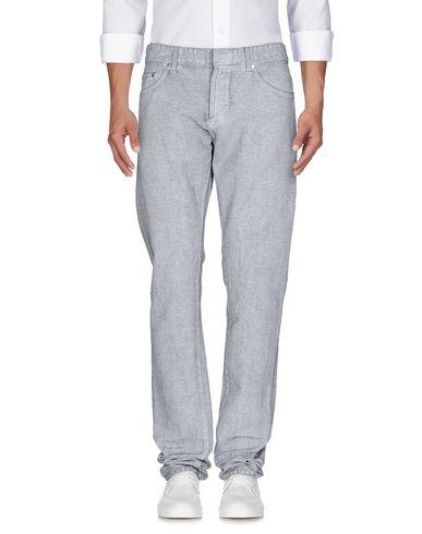 Джинсовые брюки BALENCIAGA 42569450GM