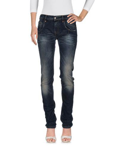 Джинсовые брюки HTC 42573463AK