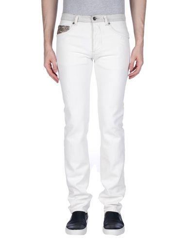Джинсовые брюки ROBERTO CAVALLI 42576354TD