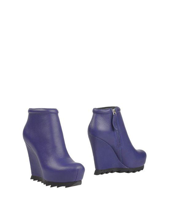 Полусапоги и высокие ботинки CAMILLA SKOVGAARD. Цвет: фиолетовый