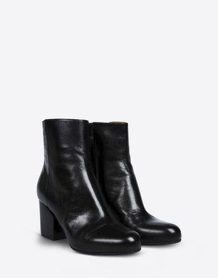 Calfskin ankle boots with slit heel