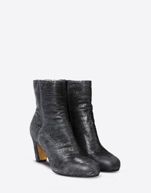 Carved leather ankle boots with curved heel