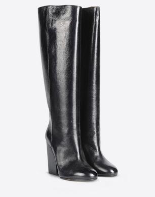 Tall calfskin boots with slit heel