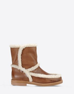 Calfskin and faux shearling ankle boots