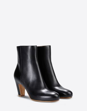 Calfskin ankle boots with curved heel