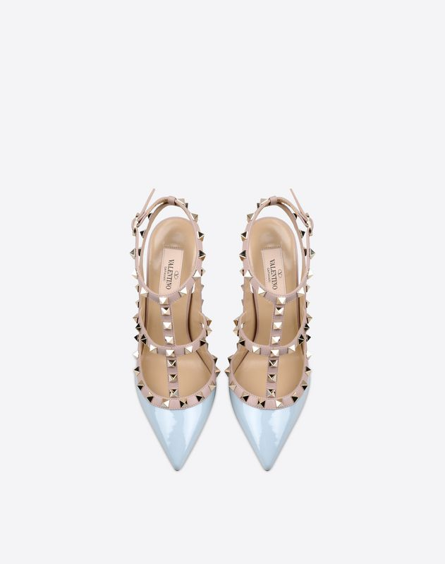 Studs<br>Two-tone pattern<br>Buckling ankle strap closure<br>Leather sole<br>Varnished effect<br>Narrow toeline<br>Covered heel<br> Women 44965544XE