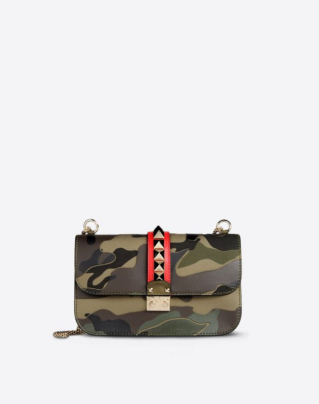 Canvas<br>Camouflage design<br>Framed closure<br>Lined interior<br>Double handle<br>Metallic inserts<br>Logo detail<br> Women 45199646qc