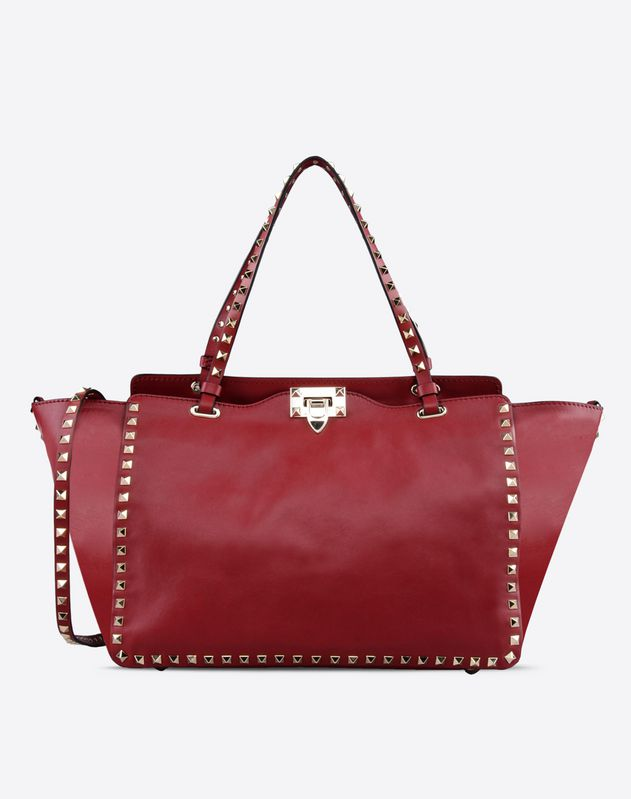 Solid color<br>Clasp closure<br>Internal zip pocket<br>Removable shoulder strap<br>Logo detail<br>Studs<br>Metallic inserts<br> Women 45206527KJ