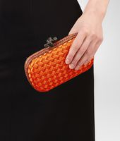 KNOT CLUTCH IN TANGERINE INTRECCIO IMPERO WITH AYERS DETAILS