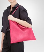 BORSA CONVERTIBLE ROSA SHOCK IN NAPPA INTRECCIATA