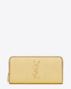 Grand portefeuille zippé Monogramme Saint Laurent en cuir grainé métallisé or