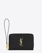 MONOGRAM SAINT LAURENT phone wallet in black grain de poudre textured matelassé leather