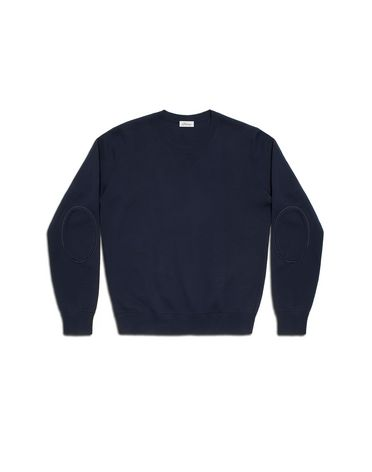 Knit sweater in wool with leather detailing