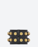 CLOUS BICYLINDRIQUES CUFF IN BLACK LEATHER AND GOLD-TONED BRASS