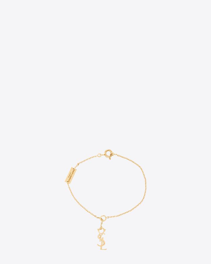 saint laurent signature monogram charm bracelet in gold vermeil