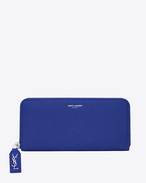classic rive gauche zip around wallet with monogrammed pull in ultramarine grained leather