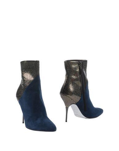 Полусапоги и высокие ботинки от RODOLPHE MENUDIER