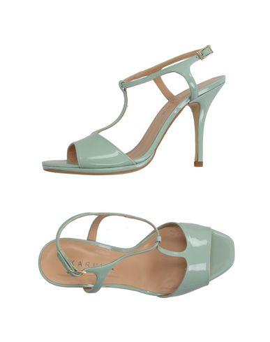 Фото - Женские сандали KARMINE светло-зеленого цвета
