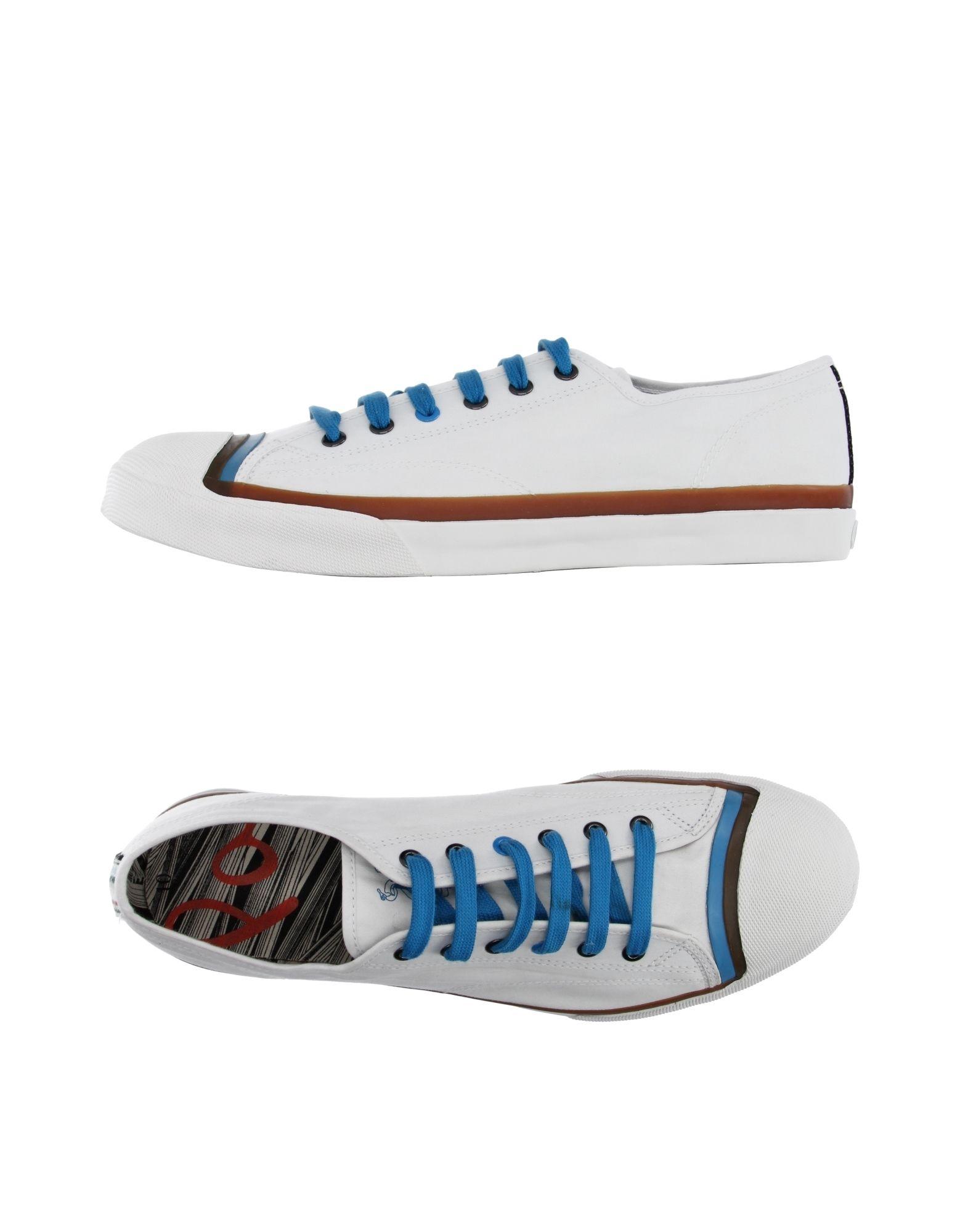 где купить  PAUL SMITH JEANS Низкие кеды и кроссовки  по лучшей цене