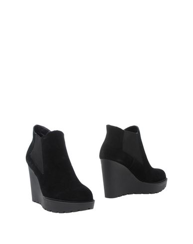 Фото - Полусапоги и высокие ботинки черного цвета