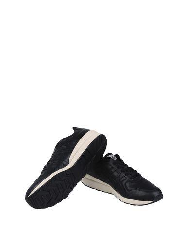 Фото 2 - Низкие кеды и кроссовки от ASICS TIGER черного цвета