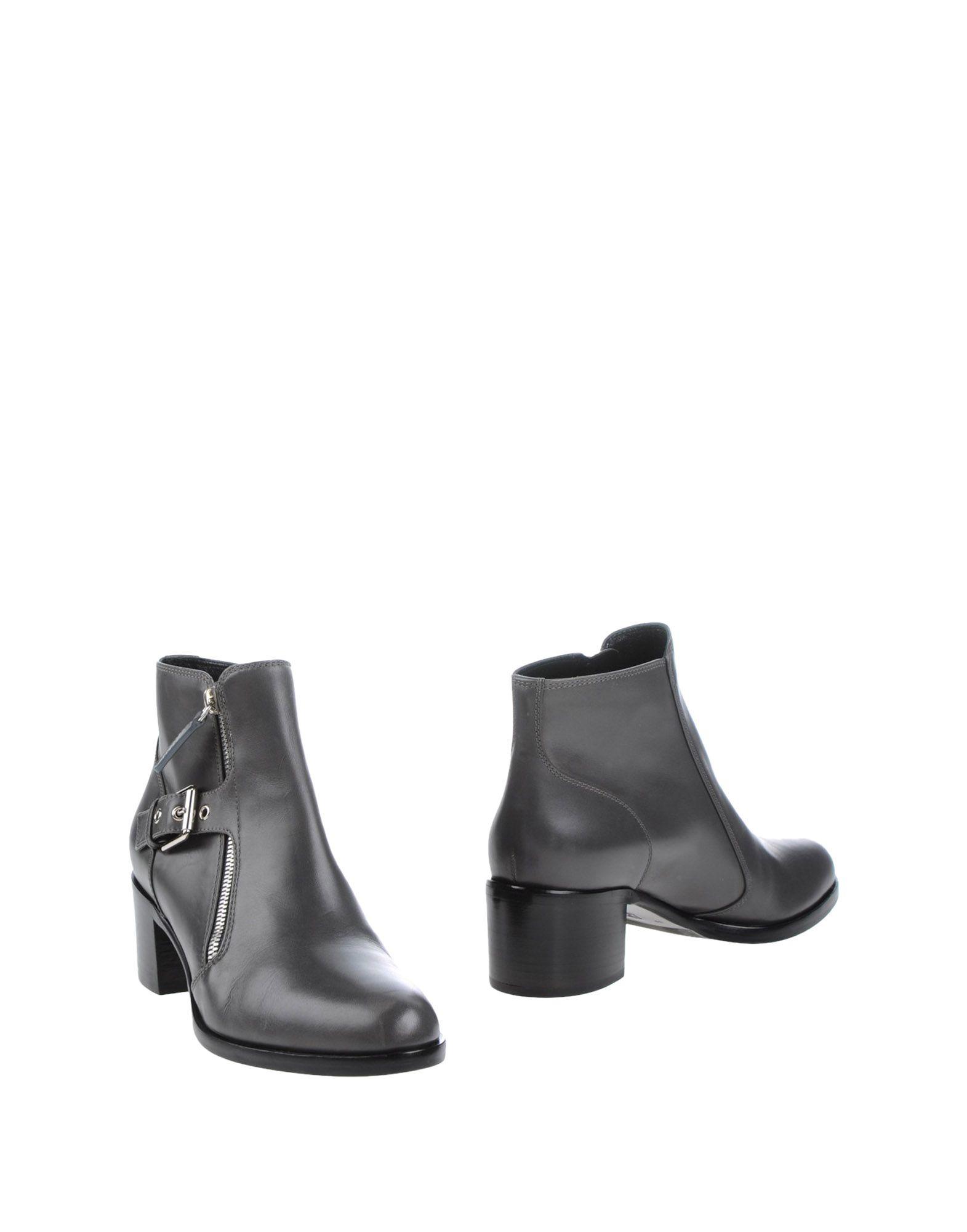 где купить  GIANVITO ROSSI Полусапоги и высокие ботинки  по лучшей цене