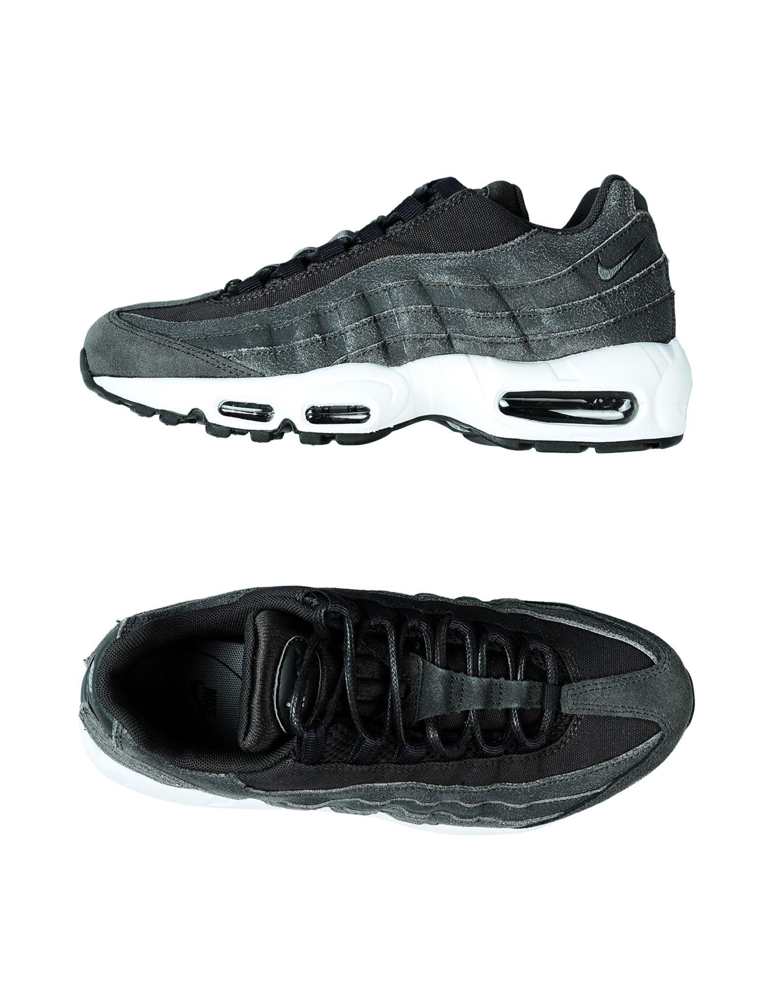 Фото NIKE Низкие кеды и кроссовки. Купить с доставкой