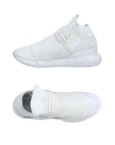 Фото - Высокие кеды и кроссовки от Y-3 белого цвета