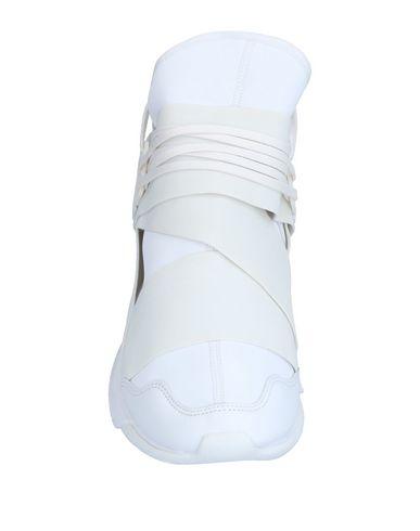 Фото 2 - Высокие кеды и кроссовки от Y-3 белого цвета