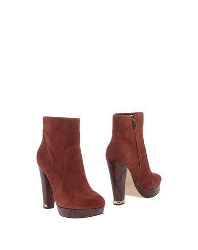 Фото - Полусапоги и высокие ботинки кирпично-красного цвета