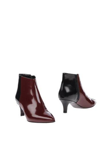 Полусапоги и высокие ботинки от TIPE E TACCHI