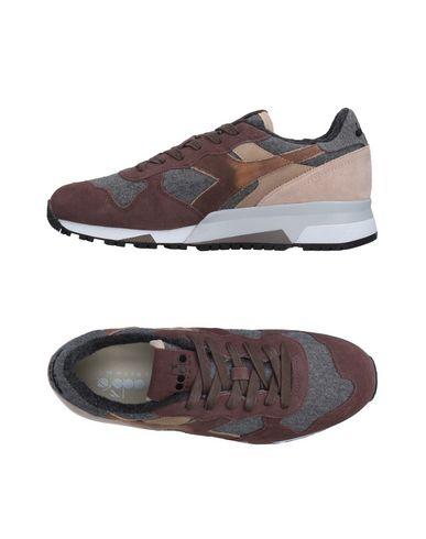 Фото - Низкие кеды и кроссовки светло-коричневого цвета