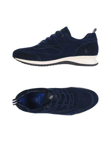 Фото - Низкие кеды и кроссовки темно-синего цвета